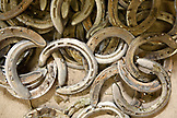 USA, Wyoming, Encampment, a pile of old worn horseshoes at Abara Ranch