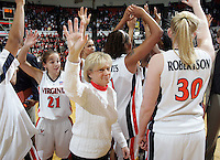 UVa head coach Debbie Ryan waves to the crowd alongside her team after beating Clemson 2-26-06. women's basketball head coach Debbie Ryan