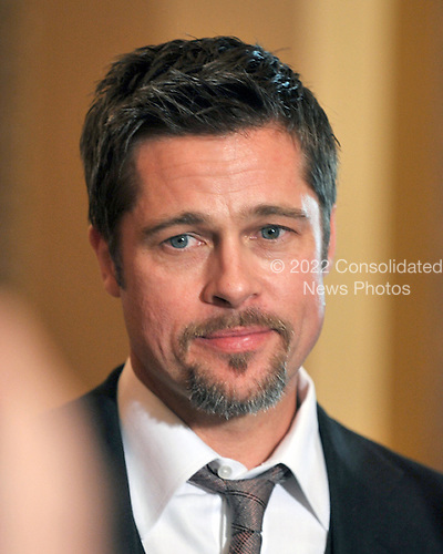 Washington, DC - March 5, 2009 -- Brad Pitt speaks to press after meeting with Democratic leadership in the U.S. Capitol in Washington, D.C. on Thursday, March 5, 2009..Credit: Ron Sachs / CNP