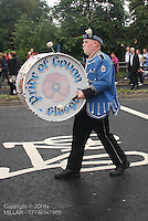Bass Drummer with Pride of Govan Flute Band with Govan District returning from the County Grand Orange Lodge of Glasgow Parade 2012 which took place in Glasgow on 7.7.12..