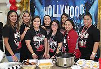 Carina Tapia (from left), Cristy Noriega, Ana Herrera, Montaserrat Martinez, Tania Moore, Adriana Martinez, Sandra Delacruz and Liliana Barajas represent Culpepper Family Dentistry at Chilirhea on Feb. 8.<br /> (Arkansas Democrat-Gazette/Carin Schoppmeyer)