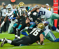 09.11.2014.  London, England.  NFL International Series. Jacksonville Jaguars versus Dallas Cowboys. Jacksonville Jaguars' Quarterback Blake Bortles (#5) is sacked