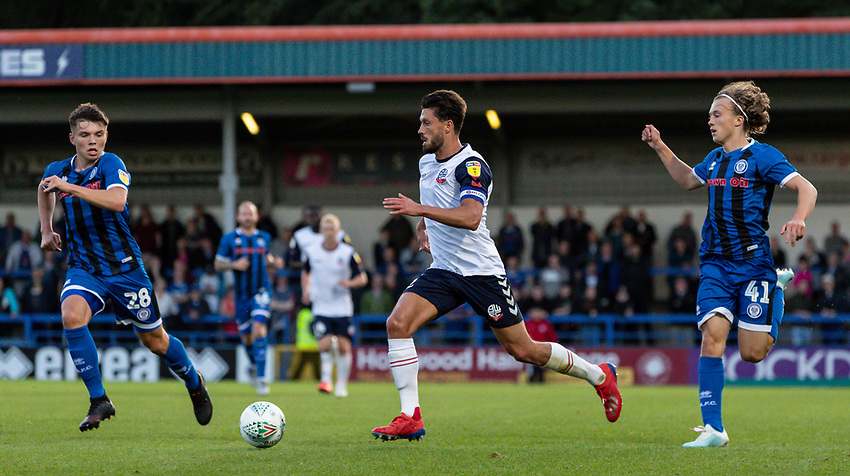 Bolton Wanderers' Jason Lowe (centre) competing with Rochdale's Aaron Morley and Luke Matheson (right) <br /> <br /> Photographer Andrew Kearns/CameraSport<br /> <br /> The Carabao Cup First Round - Rochdale v Bolton Wanderers - Tuesday 13th August 2019 - Spotland Stadium - Rochdale<br />  <br /> World Copyright © 2019 CameraSport. All rights reserved. 43 Linden Ave. Countesthorpe. Leicester. England. LE8 5PG - Tel: +44 (0) 116 277 4147 - admin@camerasport.com - www.camerasport.com