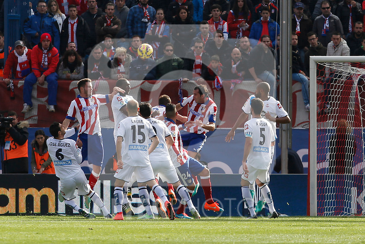 Atletico de Madrid´s Raul Jimenez, Diego Godin and Gimenez and Deportivo de la Coruña´s Rodriguez, Postiga and Laure during 2014-15 La Liga match between Atletico de Madrid and Deportivo de la Coruña at Vicente Calderon stadium in Madrid, Spain. November 30, 2014. (ALTERPHOTOS/Victor Blanco)
