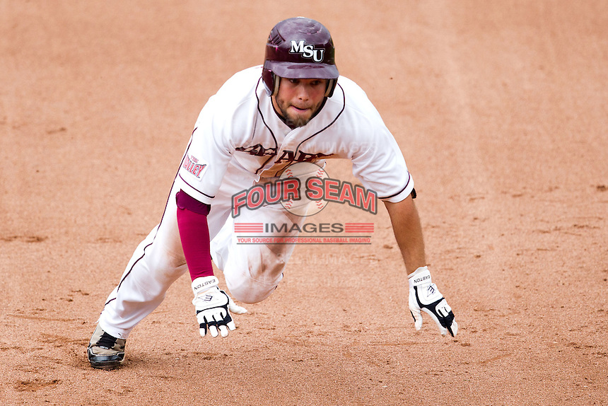 Aaron Conway (11) of the Missouri State Bears get ready to dive into third base during a game against the Bradley Braves on May 13, 2011 at Hammons Field in Springfield, Missouri.  Photo By David Welker/Four Seam Images