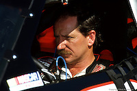 CHARLOTTE, NC - OCTOBER 6: Dale Earnhardt waits to drive during practice for the Mello Yello 500 on October 6, 1991, at the Charlotte Motor Speedway near Charlotte, North Carolina.