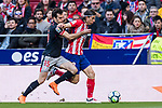 Filipe Luis of Atletico de Madrid (R) fights for the ball with Inigo Lekue of Athletic Club de Bilbao (L) during the La Liga 2017-18 match between Atletico de Madrid and Athletic de Bilbao at Wanda Metropolitano  on February 18 2018 in Madrid, Spain. Photo by Diego Souto / Power Sport Images