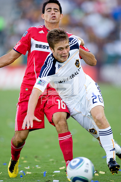 Rookie sensation Michael Stephens of the LA Galaxy attempts to move around Marco Pappa of the Chicago Fire. The Chicago Fire beat the LA Galaxy 3-2 at Home Depot Center stadium in Carson, California on Sunday August 1, 2010.