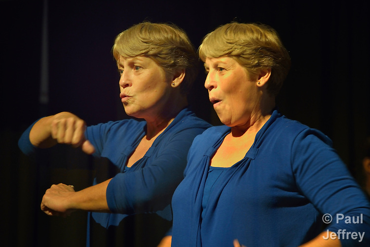 Betty Ostrom provides American Sign Language interpretation at the 2012 United Methodist General Conference in Tampa, Florida. Ostrom is a member of Pine Castle United Methodist Church in Orlando. This image is a double exposure.