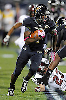 25 October 2011:  FIU wide receiver T.Y. Hilton (4) returns the opening kickoff as the FIU Golden Panthers defeated the Troy University Trojans, 23-20 in overtime, at FIU Stadium in Miami, Florida.