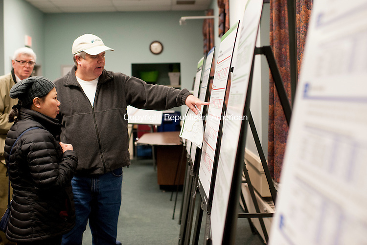 CHESHIRE, CT-21 January 2015-012115EC02-  John O'Brien checks out one of the schedules offered by CTfastrak. Laptops and maps were placed throughout Cheshire Town Hall Wednesday night to show residents what the new rapid transit system offers. Erin Covey Republican-American
