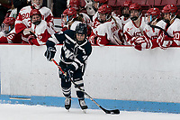 BOSTON, MA - FEBRUARY 16: Nicole Dunbar #4 of University of New Hampshire looks to pass during a game between University of New Hampshire and Boston University at Walter Brown Arena on February 16, 2020 in Boston, Massachusetts.
