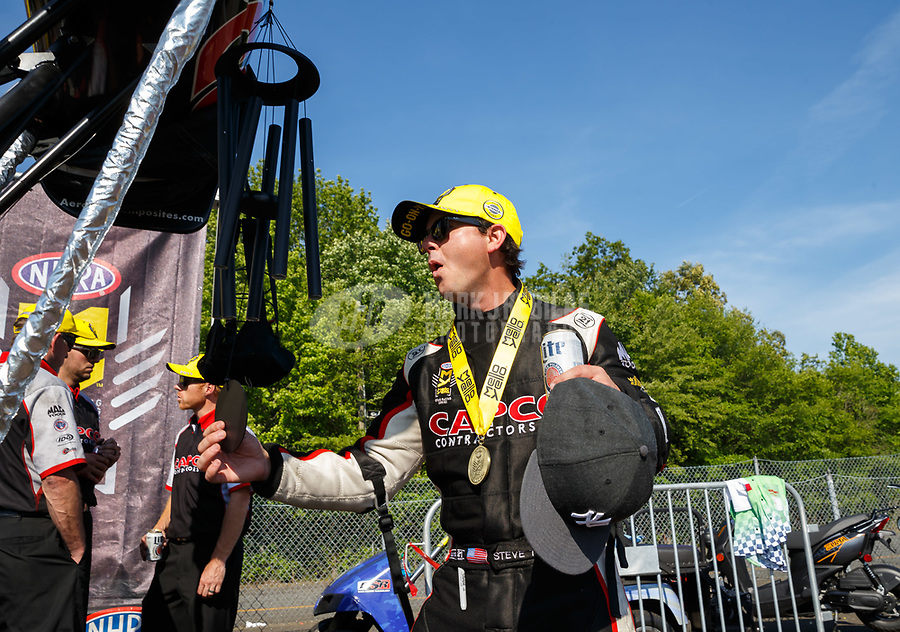 Jun 11, 2017; Englishtown , NJ, USA; NHRA top fuel driver Steve Torrence celebrates with wind chimes after winning the Summernationals at Old Bridge Township Raceway Park. Mandatory Credit: Mark J. Rebilas-USA TODAY Sports
