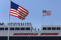 Mar 30, 2007; Martinsville, VA, USA; Spotters stand on the roof during Nascar Nextel Cup Series qualifying for the Goody's Cool Orange 500 at Martinsville Speedway. Martinsville marks the second race for the new car of tomorrow. Mandatory Credit: Mark J. Rebilas.