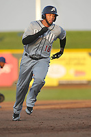 The Reno Aces Josh Bell #18 runs towards third base during the game against the Omaha Storm Chasers at Werner Park on August 3, 2012 in Omaha, Nebraska.(Dennis Hubbard/Four Seam Images)
