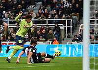 9th November 2019; St James Park, Newcastle, Tyne and Wear, England; English Premier League Football, Newcastle United versus AFC Bournemouth; Andy Carroll of Newcastle United tackles Arnaut Danjuma of AFC Bournemouth in his own penalty box late in the game - Strictly Editorial Use Only. No use with unauthorized audio, video, data, fixture lists, club/league logos or 'live' services. Online in-match use limited to 120 images, no video emulation. No use in betting, games or single club/league/player publications