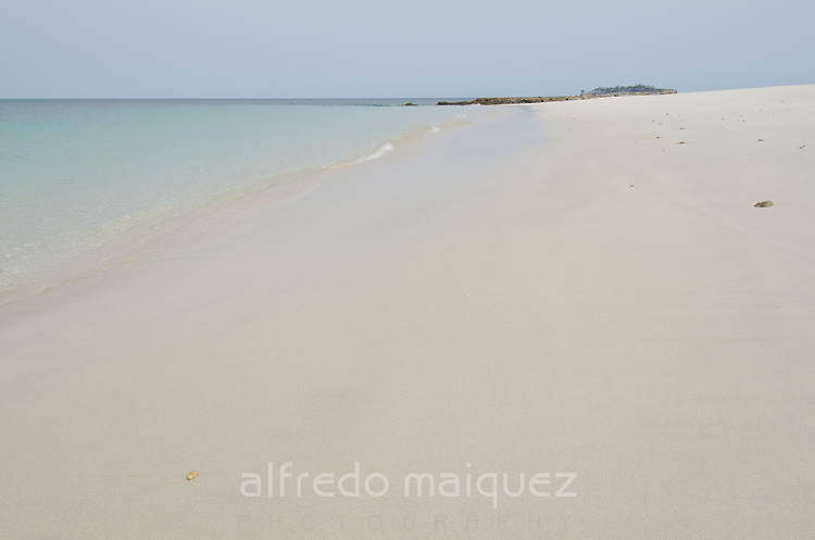 Sea waves coming to white sand beach. Pacheca Islands, Las Perlas Archipelago, Panama, Central America.