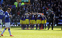 Pictured: Swansea players huddle. Sunday 16 February 2014<br />