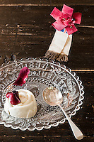 Close up of an almond and rosewater blancmange prepared by Italian chef Maddalena Caruso and served on a Queen Victoria Jubilee commemorative glass plate