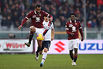 Koffi Djidji of Torino FC plays the ball back as Riccardo Orsolini of Bologna closes in during the Serie A match at Stadio Grande Torino, Turin. Picture date: 12th January 2020. Picture credit should read: Jonathan Moscrop/Sportimage
