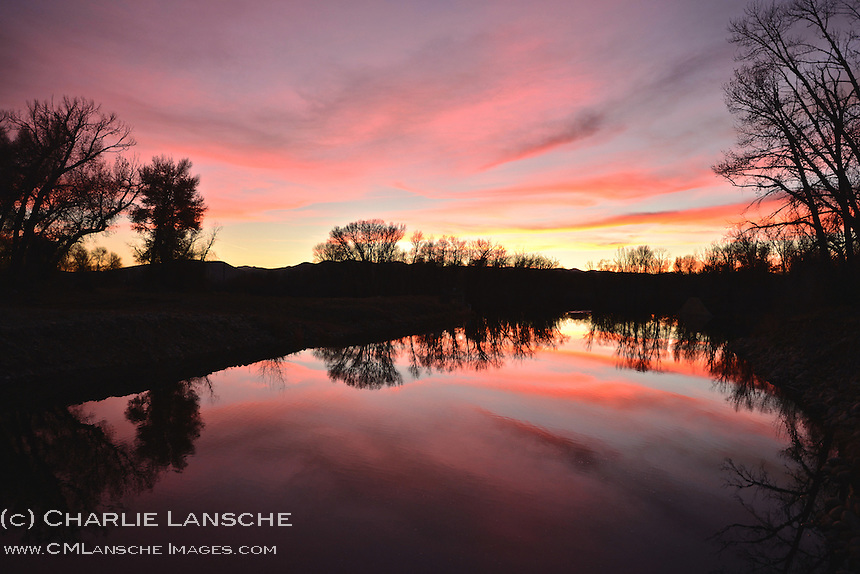 Wispy clouds created a surreal scene when the November sun dopped over the western horizon illuminating the water's surface along this slow stretch of the Weber River near Oakley, Utah.