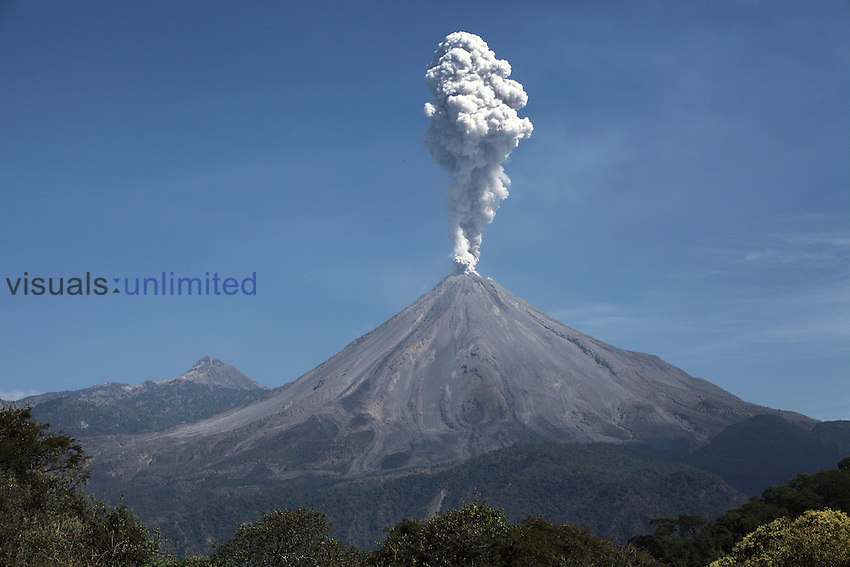 Ash cloud rising from Colima volcano following explosive eruption, Mexico. Nevado Colima is in the background.