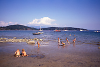 Cortez Island, BC, British Columbia, Canada - Children playing on Beach at Desolation Sound