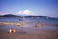 Cortez Island, BC, British Columbia, Canada - Children playing on Beach at Desolation Sound