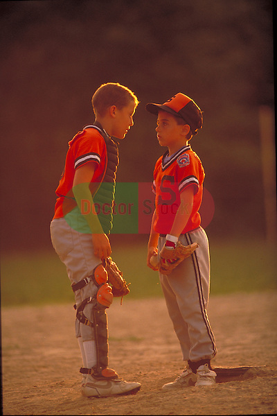 young boy little league players discussing game