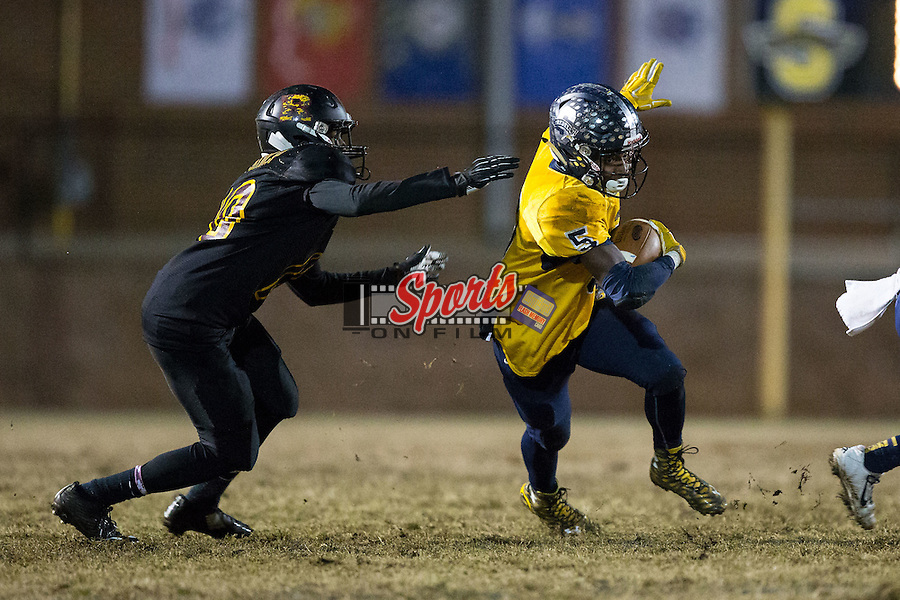 Lundon White (5) of the South Iredell Vikings tries to avoid the tackle attempt of JC Culp (10) of the JM Robinson Bulldogs during second half action at South Iredell High School November 20, 2015, in Statesville, North Carolina.  The Vikings defeated the Bulldogs 14-13.  (Brian Westerholt/Special to the Tribune)