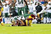 Landover, MD - August 16, 2018: Washington Redskins wide receiver Josh Doctson (18) is tackled by New York Jets defensive back Doug Middleton (36) during preseason game between the New York Jets and Washington Redskins at FedEx Field in Landover, MD. (Photo by Phillip Peters/Media Images International)
