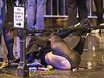 © Joel Goodman - 07973 332324 . 21/12/2013 . Manchester , UK . A woman falls over on the wet pavement . Christmas revellers out in the rain in Manchester on Mad Friday , the last Friday night before Christmas which is typically one of the busiest nights of the year for police and ambulance crews . Photo credit : Joel Goodman