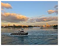 YORKVILLE, NY - SEPTEMBER 5: Photograph of tugboat passing Roosevelt Island Lighthouse on the East River from Carl Schurz Park taken in Yorkville, New York on September 5, 2012. Photo Credit: Thomas R. Pryor