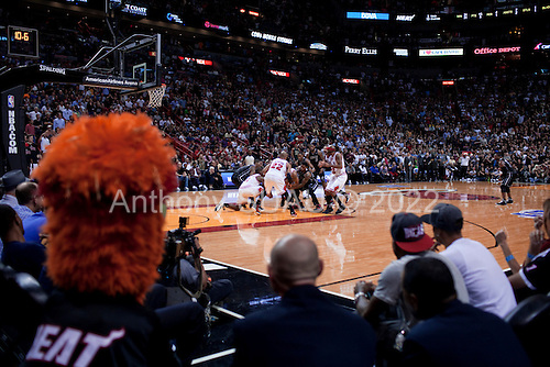 Miami, Florida<br /> January 29, 2012<br /> <br /> During the final minutes of the game the crowd was kept on its feet as the Chicago BULLs and the Miami HEAT drew fouls and fought back and forth for the lead. The ball goes free and both teams battle for possession.