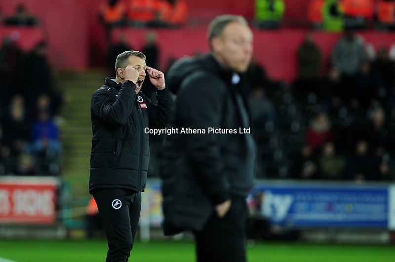 Gary Rowett Manager of Millwall shouts instructions to his team from the dug-out during the Sky Bet Championship match between Swansea City and Millwall at the Liberty Stadium in Swansea, Wales, UK. Saturday 23rd November 2019