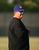 2007:  Dennis Holmberg of the Auburn Doubledays shares a laugh with the bench while coaching vs. the Williamsport Crosscutters in New York-Penn League baseball action.  Photo copyright Mike Janes Photography 2007.