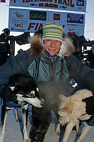 Thursday  March 15, 2007   ---- Nome, Alaska.  Silvia Willis poses with her lead dogs in Nome after finishing the Iditarod in  27th  place.