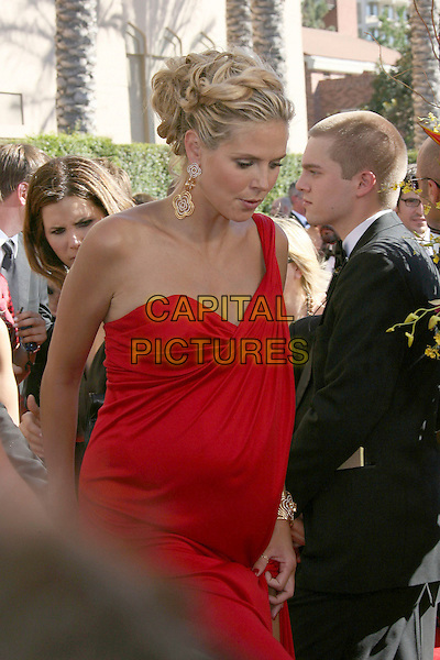 HEIDI KLUM.Red Carpet Arrivals - 58th Annual Primetime Emmy Awards held at the Shrine Auditorium,  Los Angeles, California, USA, 27 August 2006..emmys half length red dress gold earrings pregnant.Ref: ADM/ZL.www.capitalpictures.com.sales@capitalpictures.com.©Zach Lipp/AdMedia/Capital Pictures.