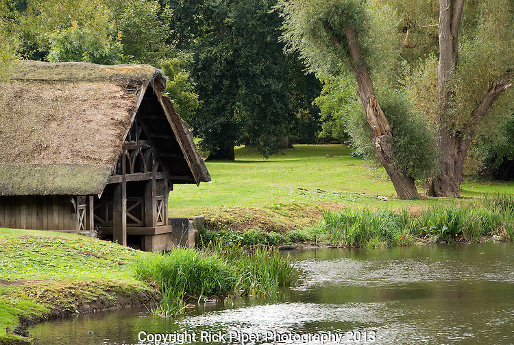 Old Boathouse - Old thatched boathouse on the River Avon, Warwick Castle, Warwick, England, UK