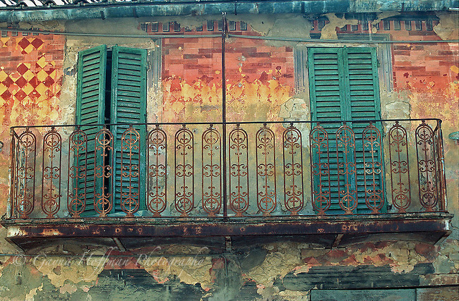 Worn, aged, painted facade on building in Togiano in Italy.