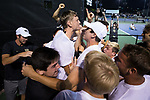 Christian Seraphim (rear) is mobbed by his teammates after his victory at #6 singles clinched the match against the Texas A&M Aggies during the semifinals at the 2018 NCAA Men's Tennis Championship at the Wake Forest Tennis Center on May 21, 2018 in Winston-Salem, North Carolina. The Demon Deacons defeated the Aggies 4-3. (Brian Westerholt/Sports On Film)