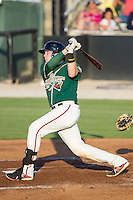 Chad Wallach (47) of the Greensboro Grasshoppers follows through on his swing against the Kannapolis Intimidators at CMC-Northeast Stadium on June 14, 2014 in Kannapolis, North Carolina.  The Grasshoppers defeated the Intimidators 4-2.  (Brian Westerholt/Four Seam Images)