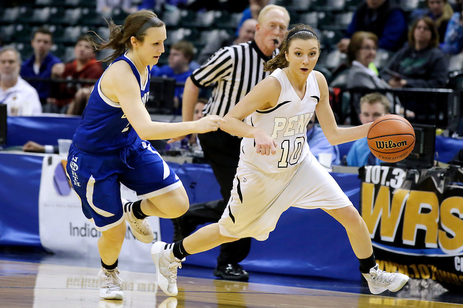 Penn guard Kaitlyn Marenyi (10) works against Columbus North guard Kenzie Patberg (24) during the IHSAA Class 4A Girls Basketball State Championship Game on Saturday, Feb. 27, 2016, at Bankers Life Fieldhouse in Indianapolis.