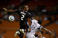 Julius James (2) of D.C. United tries to get a head on the ball as it flies through the box next to Rauwshan McKenzie (30) of Real Salt Lake during a U.S. Open Cup tournament game at RFK Stadium in Washington, DC.  D.C. United defeated Real Salt Lake, 2-1, in overtime.