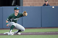 Michigan State Spartans third baseman Marty Bechina (2) waits for a throw from the outfield against the Michigan Wolverines during the NCAA baseball game on April 18, 2017 at Ray Fisher Stadium in Ann Arbor, Michigan. Michigan defeated Michigan State 12-4. (Andrew Woolley/Four Seam Images)