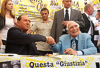 Il leader del Popolo della Liberta' Silvio Berlusconi stringe la mano al leader radicale Marco Pannella, destra, dopo aver firmato le proposte dei referendum sulla giustizia e sui diritti umani e civili in un gazebo dei Radicali a Roma, 31 agosto 2013.<br /> Italian former Premier Silvio Berlusconi shakes hands with Radical leader Marco Pannella, right, after signing for Radical Party referendum proposal on justice and human and civil rights in Rome, 31 August 2013.<br /> UPDATE IMAGES PRESS/Isabella Bonotto