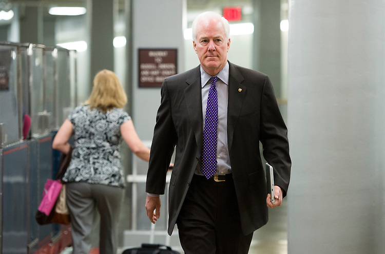 UNITED STATES - SEPTEMBER 9: Sen. John Cornyn, R-Texas, arrives in the Capitol by way of the Senate subway on Monday, Sept. 9, 2013. (Photo By Bill Clark/CQ Roll Call)