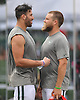 Ryan Fitzpatrick #14, New York Jets starting quarterback, right, and tight end #88 Jace Amaro joke around after a day of team training camp at Atlantic Health Jets Training Center in Florham Park, NJ on Friday, Aug. 5, 2016