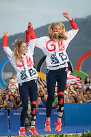 Gold medallists Great Britain's Hannah Mills and Saskia Clark celebrate on the podium of the 470 Women medal race at Marina da Gloria during the Rio 2016 Olympic Games in Rio de Janeiro on August 18, 2016.<br /> CAP/CAM<br /> &copy;CAM/Capital Pictures /MediaPunch ***NORTH AND SOUTH AMERICAS ONLY***