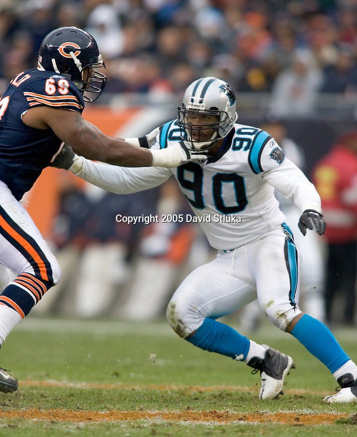 Ofensive lineman Fred Miller #69 of the Chicago Bears pass blocks during an NFL footbll game against defensive lineman Julias Peppers #90 of the Carolina Panthers on November 20, 2005 at Soldier Field in Chicago, Illinois. The Bears defeated the Panthers 13-3. (Photo by David Stluka)